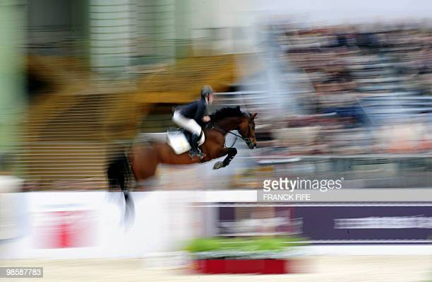 German Marcus Ehning, riding Sabrina, competes during the International Jumping Competition on April 4 at The Grand Palais in Paris. Ehning won the...