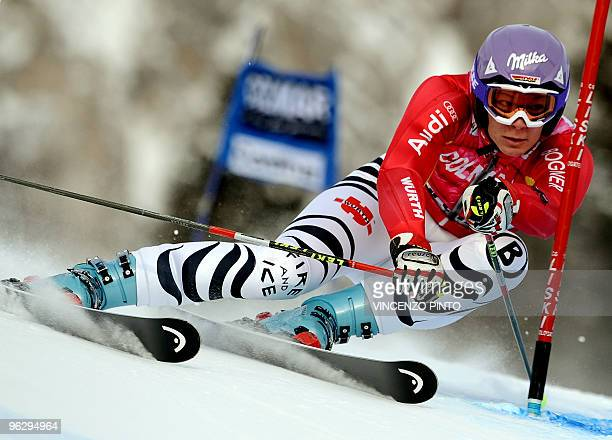 German Maria Riesch clears a gate during the first run of the women's World Cup ski Giant Slalom race in Cortina d'Ampezzo on January 24 2010 Riesch...