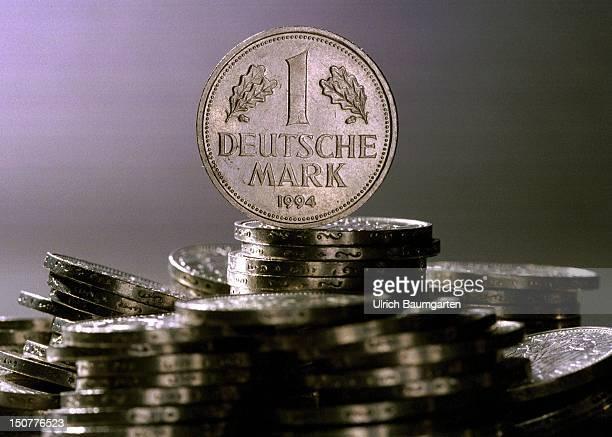 German marks coin on a coin pile