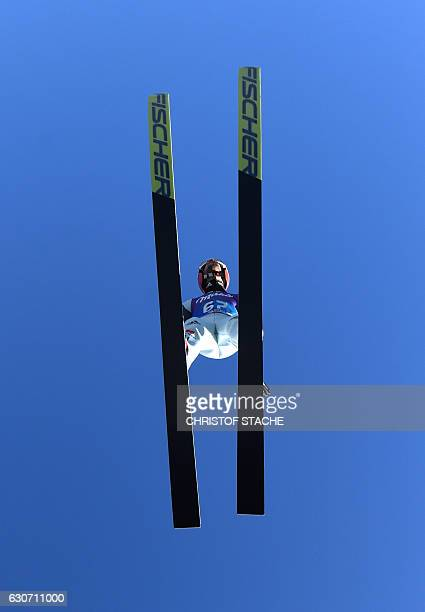 German Markus Eisenbichler soars through the air during his training jump of the ski jumping event in GarmischPartenkirchen southern Germany which is...
