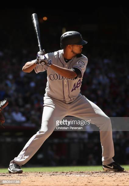 German Marquez of the Colorado Rockies bats against the Arizona Diamondbacks during the MLB game at Chase Field on April 30 2017 in Phoenix Arizona
