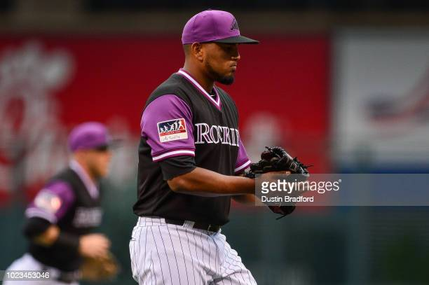 German Marquez of the Colorado Rockies claps after a scoreless first inning against the St Louis Cardinals in the first inning at Coors Field on...