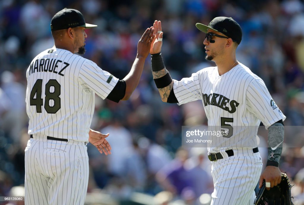 German Marquez #48 of the Colorado Rockies high fives Carlos Gonzalez #5 of the Colorado Rockies after the Rockies 8-2 victory over the Cincinnati Reds at Coors Field on May 27, 2018 in Denver, Colorado.