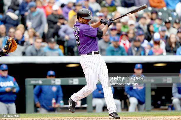 German Marquez of the Colorado Rockies hits a 2 RBI single in the seventh inning against the Chicagpo Cubs at Coors Field on May 10 2017 in Denver...