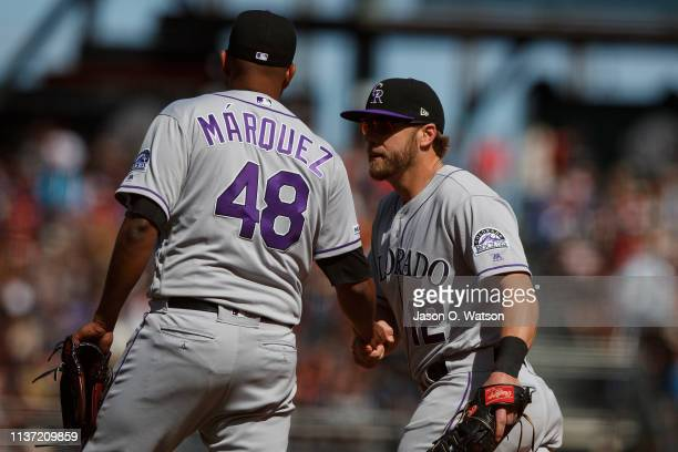 German Marquez of the Colorado Rockies is congratulated by Mark Reynolds after the game against the San Francisco Giants at Oracle Park on April 14...