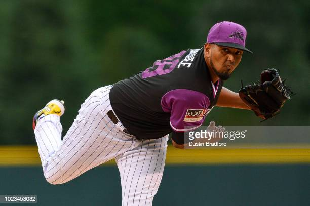 German Marquez of the Colorado Rockies pitches against the St Louis Cardinals in the first inning at Coors Field on August 25 2018 in Denver Colorado...