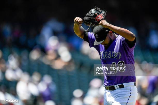 German Marquez of the Colorado Rockies throws his hands up after being relieved in the third inning after allowing 11 runs in 2 and 2/3 innings of...