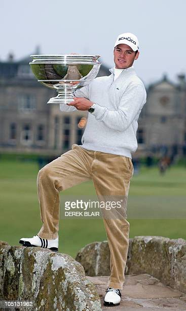 German Martin Kaymer poses with his trophy after winning the 10th Alfred Dunhill Links Golf Championship at St Andrews in Scotland on October 10 2010...