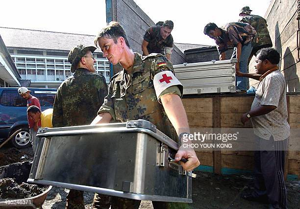 German medical unit from the German army unload medical stuff to help Indonesian victims at a hospital in Banda Aceh 08 January 2005 Some 25 German...