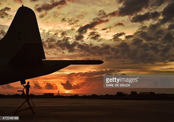 A German member of the European Naval Force makes technical checks to an antipiracy reconnaissance plane as part of operation ATALANTA at the French...