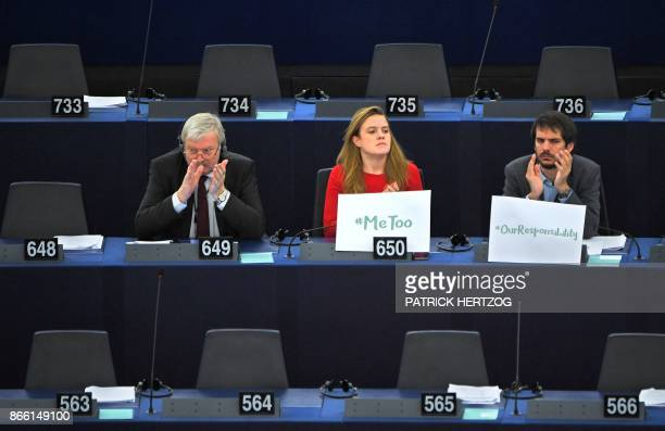 German MEP Terry Reintke sits with a '#metoo' placard next to Lithuanian MEP Bronis Rope and Austrian MEP Michel Reimon during a debate about...