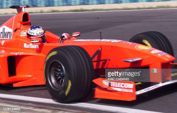 German Michael Schumacher speeds his Ferrari, 15 August on the Hungaroring racetrack in Budapest, during the second free practice session of the...