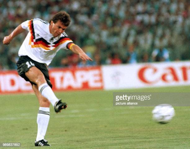 German midfielder and team captain Lothar Matthaeus kicks the ball acrosss the field during the 1990 World Cup final Germany against Argentina in...