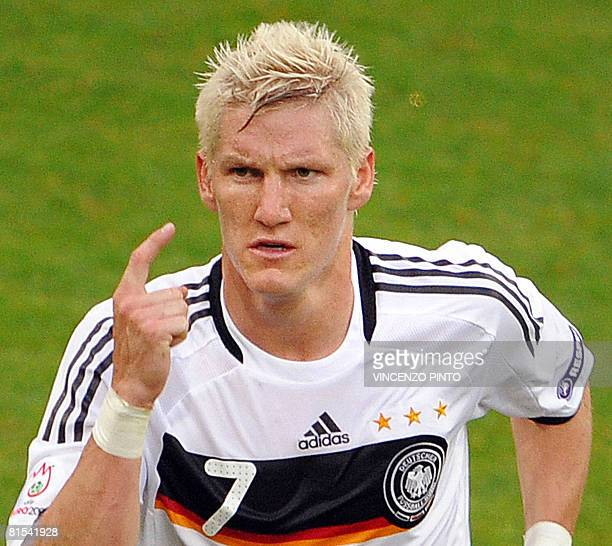 German midfielder Bastian Schweinsteiger gestures as he leaves the pitch after being given a red card by Belgian referee Frank De Bleeckere during...
