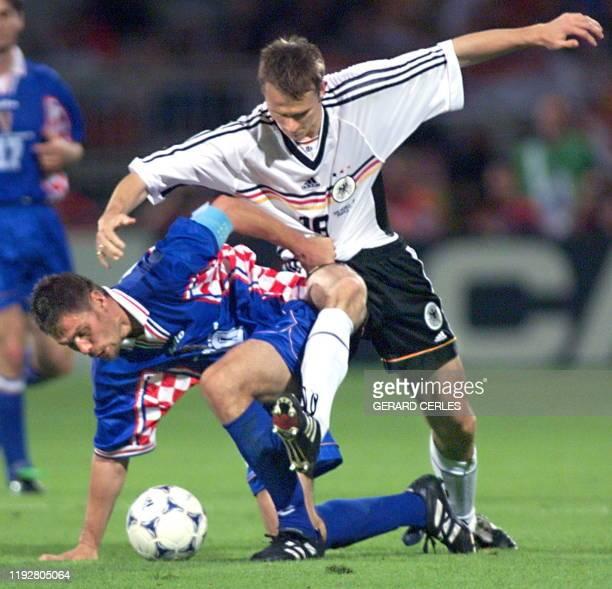 German midfielder Dietmar Hamann and Croatian midfielder and captain Zvonimir Boban vie during the 1998 Soccer World Cup quarter final match between...