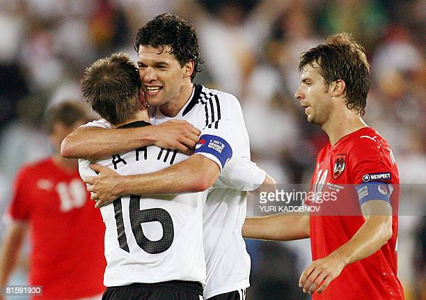 German midfielder Michael Ballack celebrates with German defender Philipp Lahm as they stand next to Austrian midfielder Andreas Ivanschitz after the...