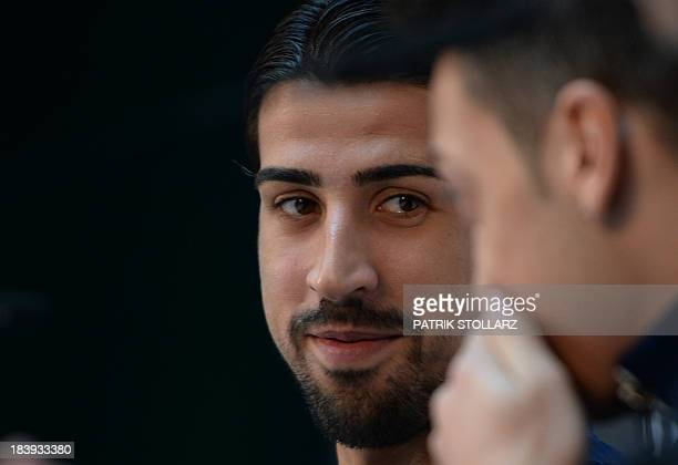 German midfielder Sami Khedira and German midfielder Mesut Oezil address a press conference in Cologne on October 10 2013 Germany will face the...