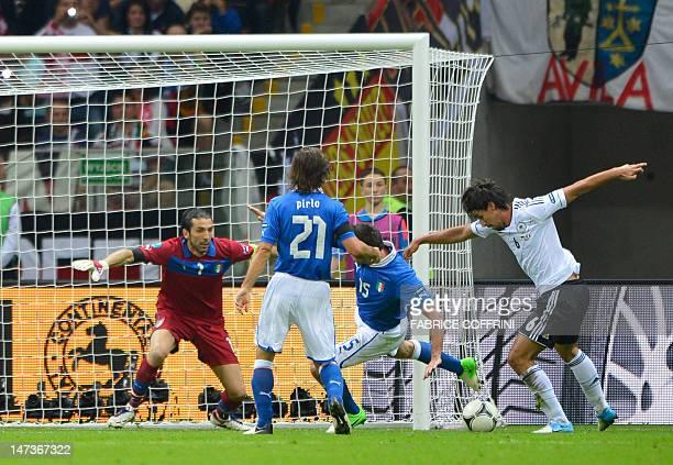 German midfielder Sami Khedira prepares to shoot at Italian goalkeeper Gianluigi Buffon during the Euro 2012 football championships semifinal match...