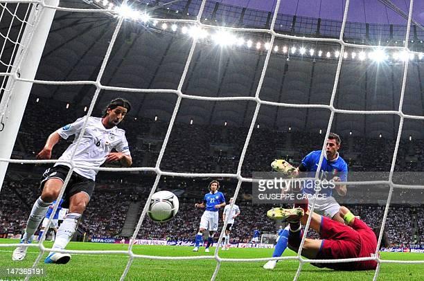 German midfielder Sami Khedira runs after the ball as Italian goalkeeper Gianluigi Buffon misses it during the Euro 2012 football championships...
