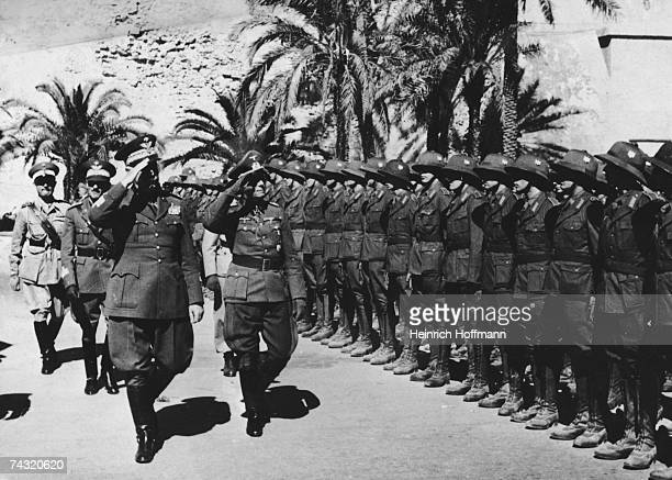 German military commander Erwin Rommel and Italian General Italo Gariboldi inspect the German troops in Africa during World War II 21st April 1941