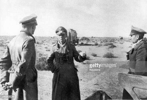 German military commander Erwin Rommel takes refreshments in Tobruk during World War II circa 1942