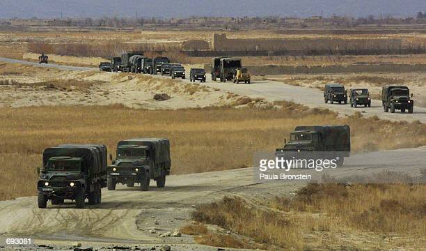 German military convoy travels toward Kabul January 11, 2002 after arriving at Bagram Airport. The peacekeeping troops are in Afghanistan as part of...