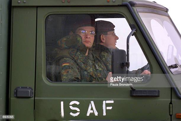 German military convoy travels towards Kabul January 11, 2002 after arriving at Bagram Airport. The peacekeeping troops are in Afghanistan as part of...