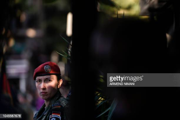 A German military police serving in a NATO ledpeacekeeping mission in Kosovo attends a farewell ceremony of their service in the town of Prizren on...