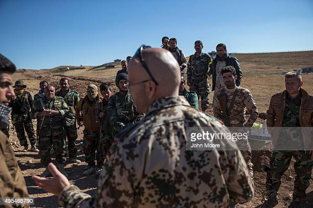 German military trainer briefs Kurdish Peshmerga forces during the last week of a training course on November 3 2015 in Erbil Iraq The Kurdish troops...