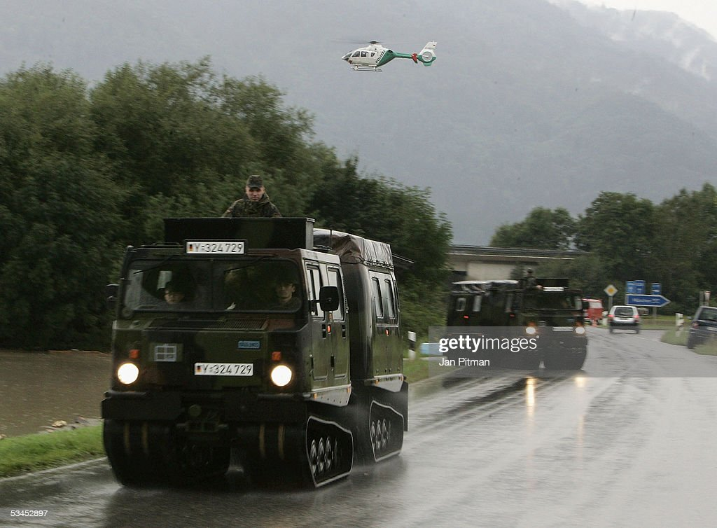 German Military vehicles drive on a motorway on August 23, 2005 in Eschenlohe, Germany. Heavy rainfall and floods in both Austria and Switzerland caused many of the rivers in southern Germany to flood. Half of Eschenlohe town has been evacuated and streets in the whole area are closed to traffic.