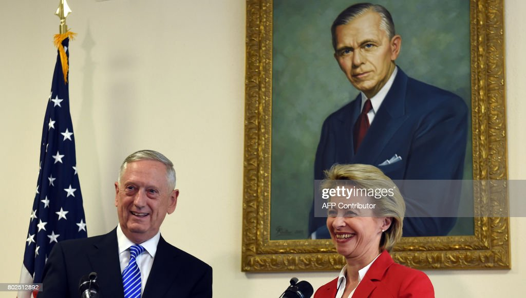 German Minister for Defense Ursula von der Leyen (R) and US Secretary of Defense James N. Mattis (L) react after a joint press statement, prior to a commemoration ceremony of the 70th anniversary of the Marshall Plan to rebuild a ravaged Europe after World War II, at the George C Marshall European Center for Security Studies in Garmisch-Partenkirchen, southern Germany, on June 28, 2017. / AFP PHOTO / Christof STACHE