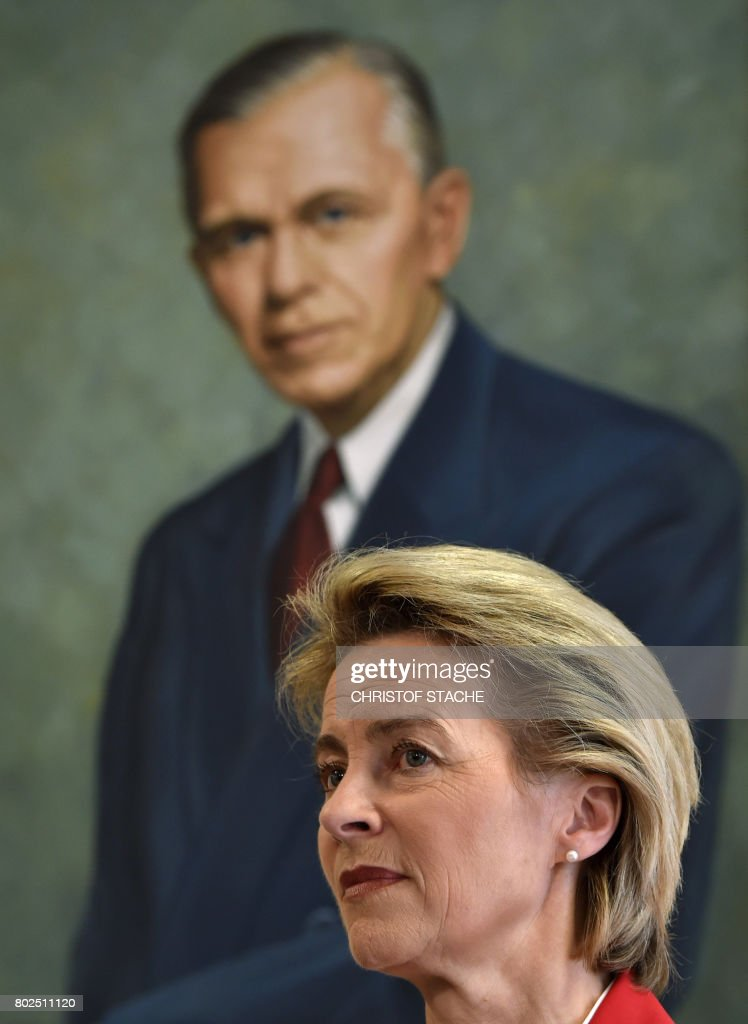 German Minister for Defense Ursula von der Leyen is pictured in front of a painting of former US general George C Marshall during a joint press statement with US Secretary of Defense James N. Mattis (unseen), prior to a commemoration ceremony of the 70th anniversary of the Marshall Plan to rebuild a ravaged Europe after World War II, at the George C Marshall European Center for Security Studies in Garmisch-Partenkirchen, southern Germany, on June 28, 2017. / AFP PHOTO / Christof STACHE