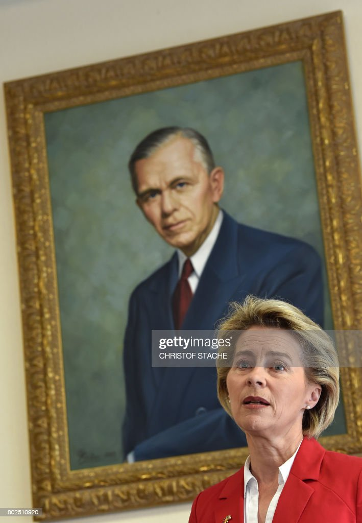 German Minister for Defense Ursula von der Leyen speaks in front of a painting of former US general George C Marshall during a joint press statement with US Secretary of Defense James N. Mattis (unseen), prior to a commemoration ceremony of the 70th anniversary of the Marshall Plan to rebuild a ravaged Europe after World War II, at the George C Marshall European Center for Security Studies in Garmisch-Partenkirchen, southern Germany, on June 28, 2017. / AFP PHOTO / Christof STACHE