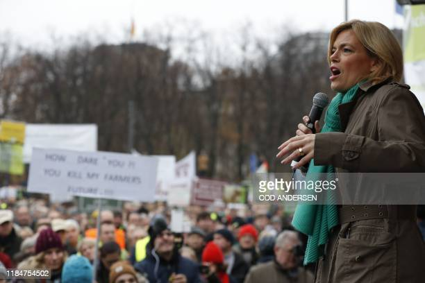 German Minister for Food and Agriculture Julia Kloeckner speaks on the stage near the Brandenburg Gate after a protest against the German...