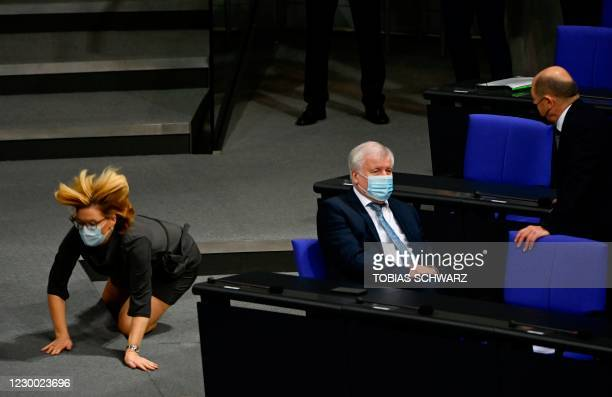 German Minister for Food and Agriculture Julia Kloeckner stumbles over a step as German Interior Minister Horst Seehofer and German Finance Minister...