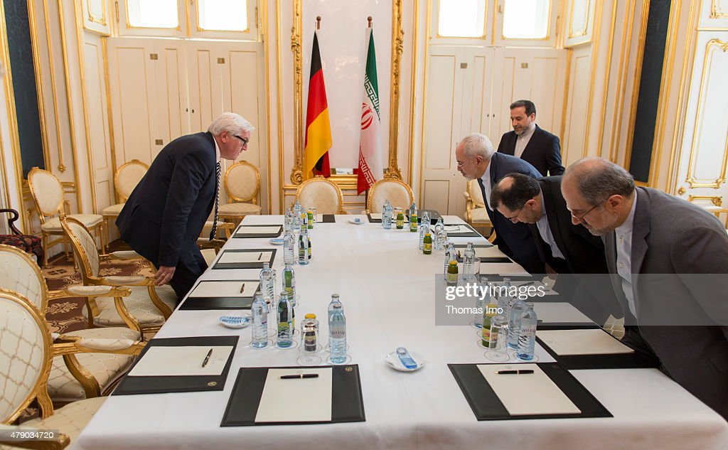 German Minister for Foreign Affairs Frank-Walter Steinmeier (L) and Iran's Minister of Foreign Affairs Mohammad Javad Zarif (3.v.R) attend a meeting at the Palais Coburg Hotel, the venue of the nuclear talks in Vienna, Austria on June 28, 2015. Negotiators with USA, Britain, China, France, Germany and Russia are meeting with Iran to finalize an interim deal over Iran's nuclear program. Photo by Thomas Imo/Photothek via Getty Images)