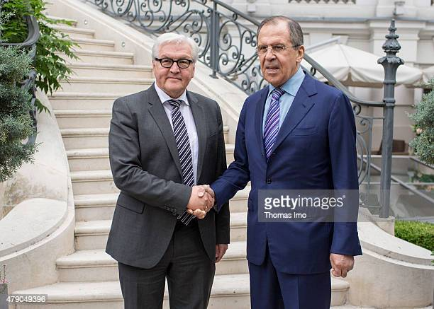 German Minister for Foreign Affairs FrankWalter Steinmeier and Russian Foreign Minister Sergei Lawrow attend a meeting at the Palais Coburg Hotel the...