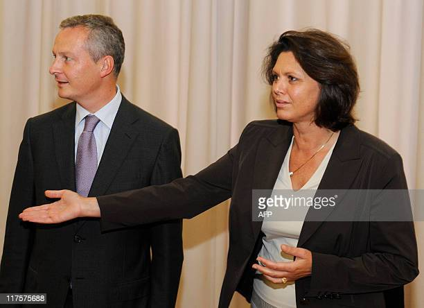 German Minister of Agriculture Ilse Aigner shows her French counterpart Bruno Le Maire the way prior to a signing ceremony at the ministry of...