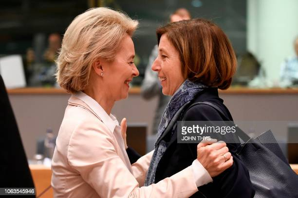 German Minister of Defence Ursula von der Leyen greets French Defence Minister Florence Parly during an EU defence ministers meeting at the EU...
