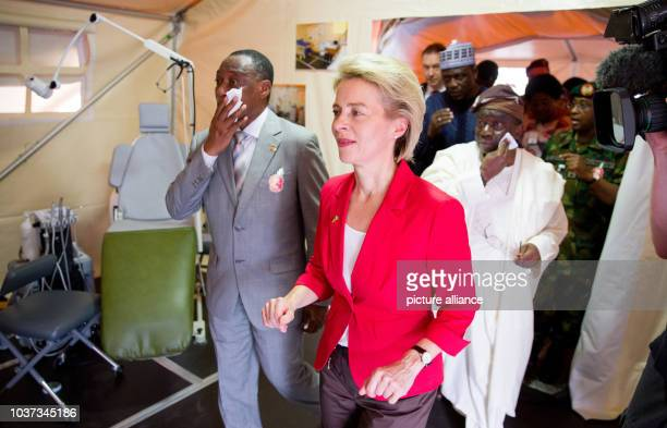 German Minister of Defense Ursula von der Leyen hands over a mobile medical facility and metal detectors for the search of landmines to her Nigerian...