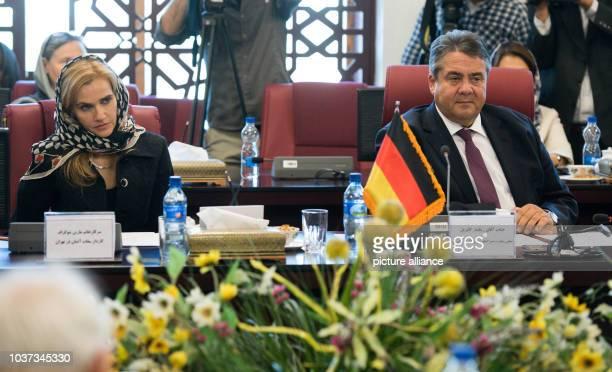 German Minister of Economic Affairs Sigmar Gabriel listens to a speech from Ali Tayebnia Iranian Minister of Economic Affairs and Finance with...