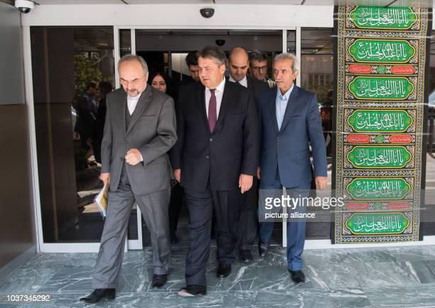 German Minister of Economic Affairs Sigmar Gabriel the Iranian Ambassador to Germany Alireza Sheikhattar and Gholam Hossein Shafee President of the...