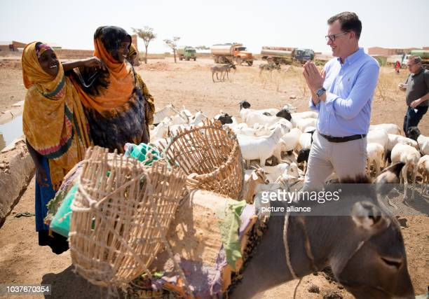 German Minister of Economic Cooperation and Development Gerd Mueller speaks at a water point with residents of Kebri Dahar in the famine and...