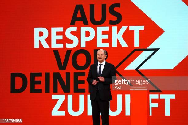 German Minister of Finance and Social Democratic Party top candidate for the federal elections Olaf Scholz stands on the stage prior to his speech...