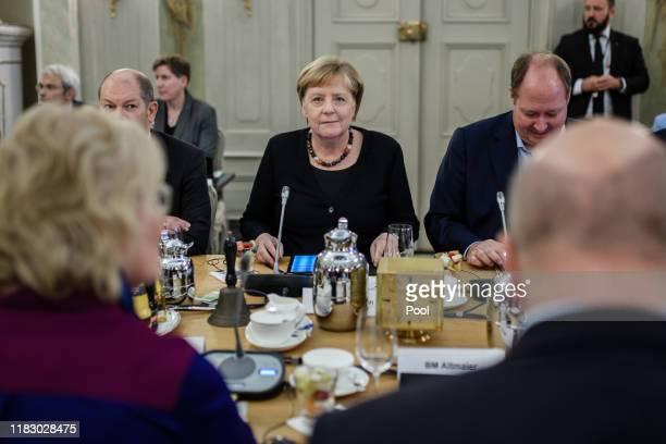 German Minister of Finance Olaf Scholz German Chancellor Angela Merkel German Chancellery Minister Helge Braun German Minister of Economy and Energy...