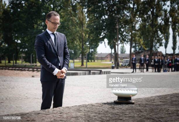 German Minister of Foreign Affairs Heiko Maas places a glass candle bowl at the International Monument to the Victims of Fascism at the former...