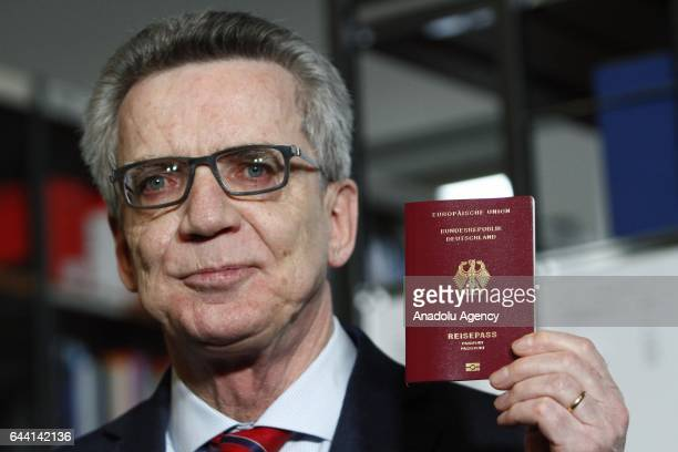 German Minister of Interior Thomas de Meziere presents the new Passport of Germany as it will be available for every german Citizen after 1st March...