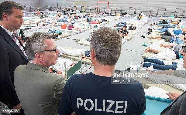 German Minister of the Interior Thomas de Maizere visits an initial registration center of the German federal police on August 11 2015 in Deggendorf...