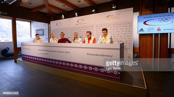 German Minister of the Interior Thomas de Maiziere is seen on the podium with Denise Herrmann Stefanie Boehler president of the German Olympic Sports...