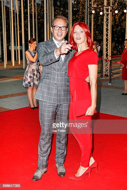 German minister of transport Alexander Dobrindt and Miss IFA attend the IFA 2016 opening gala on September 1 2016 in Berlin Germany